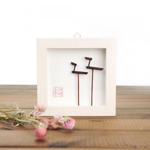 A picture of frame with a pole signifying prayer for a good harvest